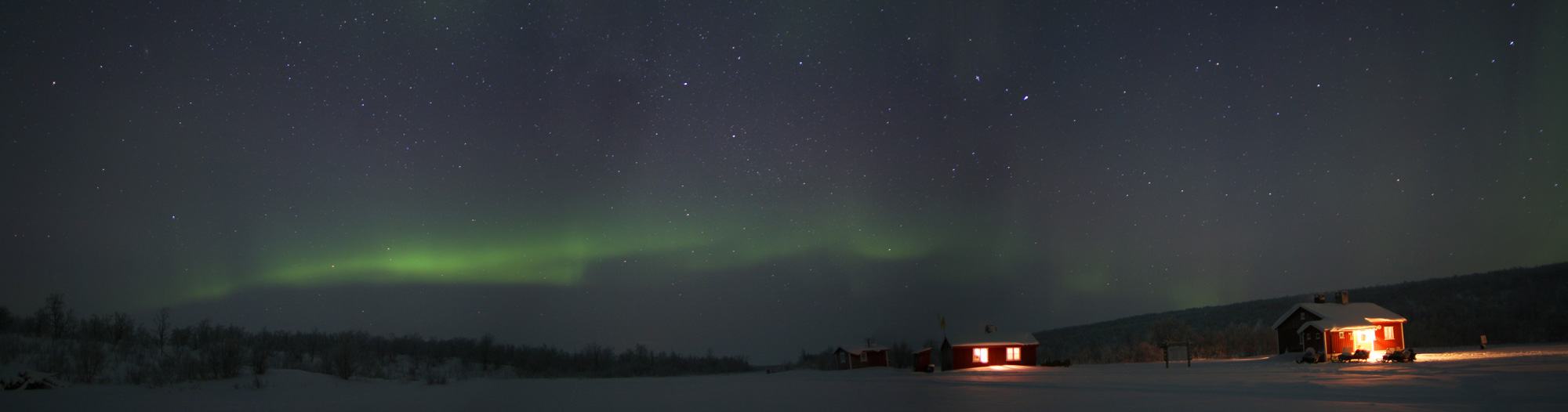 Panorama of the Aurora over the cabins early one evening.