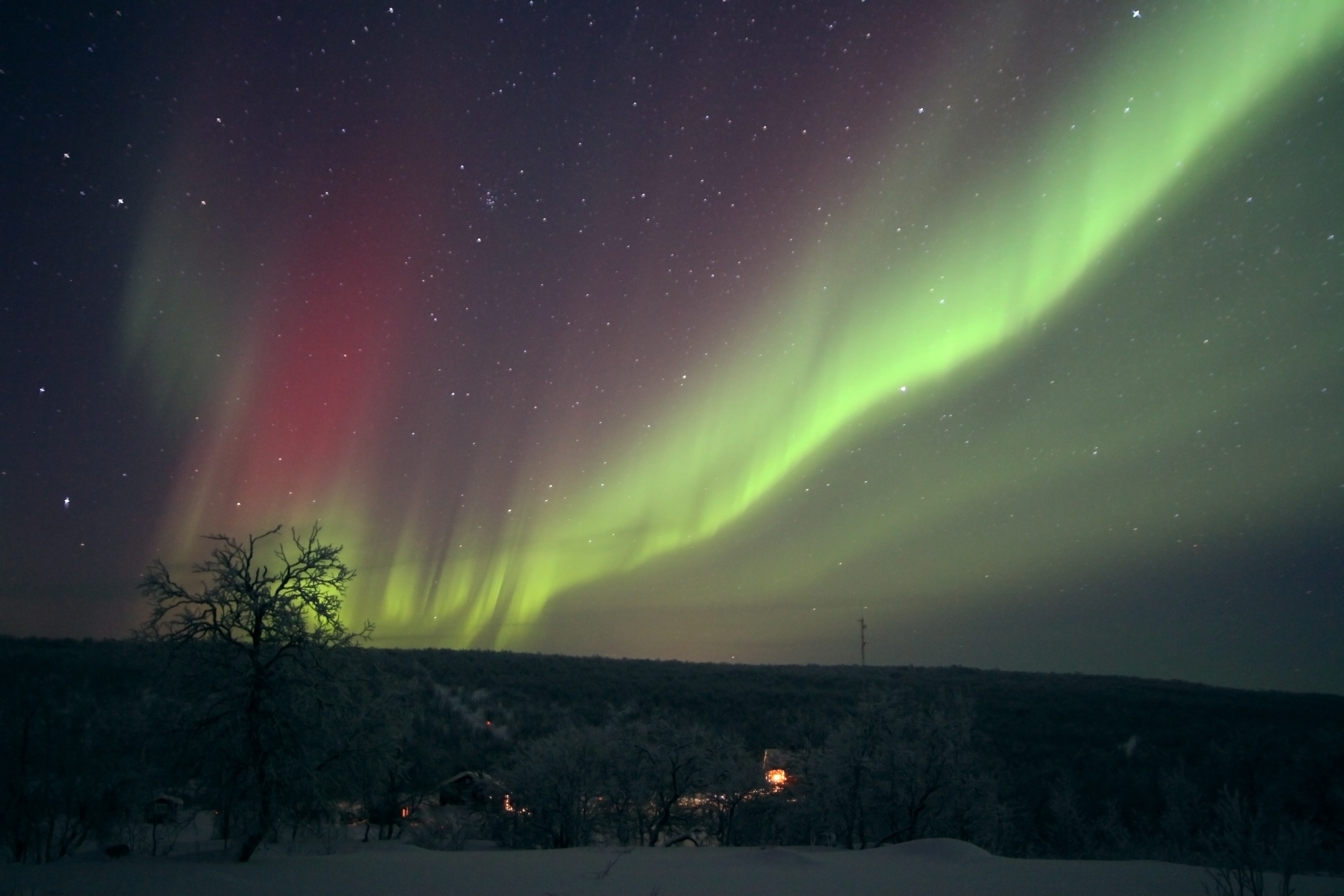 The colour of the Aurora depends on the hight and the energy of the incoming solar particles. You can get red, green, yellow and even blue.